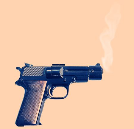 smoking gun, evidence of a crime. pistol that have just been fired with smoke  from barrel photo