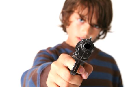 child with gun isolated on white. kid playing gangster or criminal Stock Photo