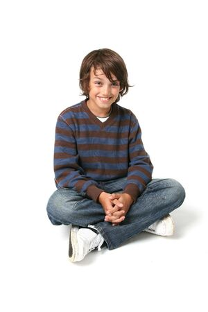 Child boy sitting. happy kid sat isolated on white background with jeans Stock Photo - 5788395