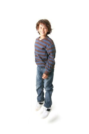 child jumping, happy teenager or kid boy jump isolated on white Stock Photo - 5796061