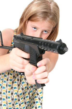 girl with gun isolated on white. child or teenager in dress with army machine gun toy Stock Photo - 5788406