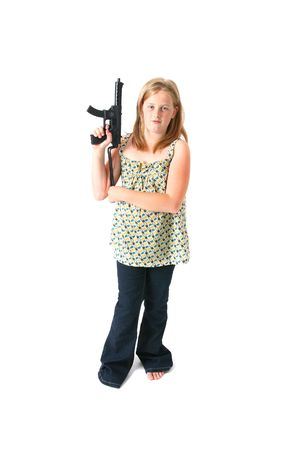 girl with gun isolated on white. child or teenager in dress with army machine gun toy photo