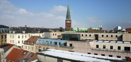 rooftop view of Aarhus town center in denmark. church spire and residential buildings Stock Photo