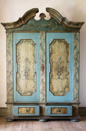 antique painted cupboard. old hand made furniture in wood with drawers and doors photo