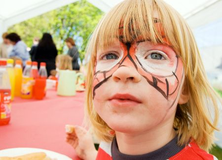 Face Paint On Child At Birthday Party Celebration Boy Kid Pretend To Be Tiger Or