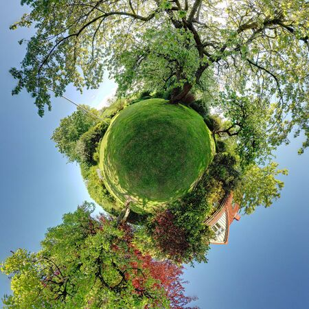 garden panorama with trees lawn and house. A home planet circular panoramic image