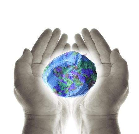 heal the planet. hands holding a deflated earth protecting the environment Stock Photo - 5837529