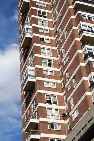 highrise building of apartments. flats in block in england against a blue sky Stock Photo - 5837569