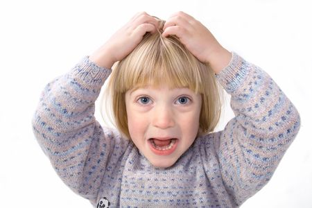 lice: Child scratch head that itch or holds head in frustration or anger whilst screaming. boy isolated on white