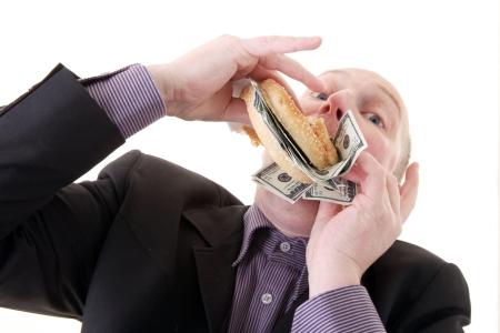 avidit�, imprenditore di mangiare il denaro. uomo mangiare dollari nel display di avarizia isolato su bianco.  Archivio Fotografico