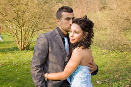 asian bride: ethnic couple at engagement or wedding. young turkish people together in love with blue dress and suit