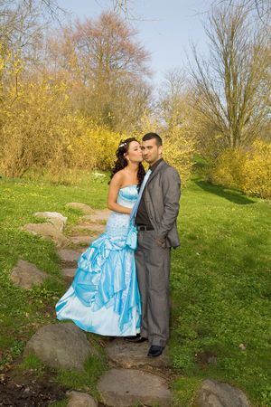 ethnic couple at engagement or wedding. young turkish people together in love with blue dress and suit photo