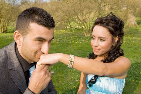 turkish man: ethnic couple at engagement or wedding. young turkish people together in love with blue dress and suit
