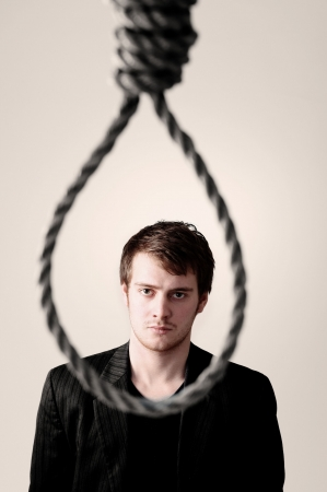 concede: businessman in front of noose or failure. man commit suicide or criminal ready for hanging punishment.