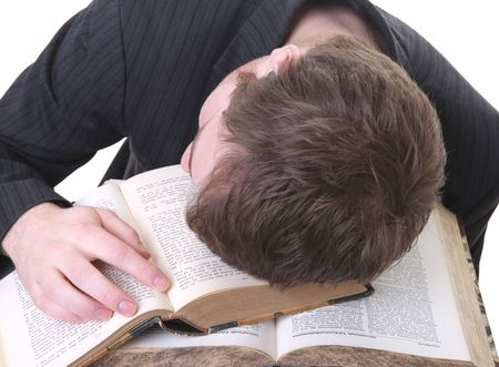 student sleep on book he is studying. male tirred from reading and abandon it to fatigue photo