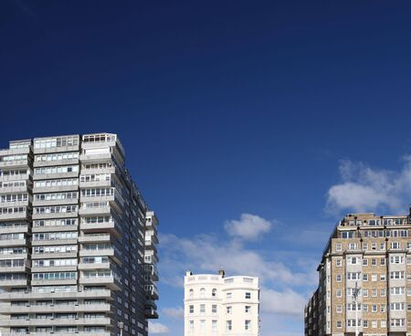 towerblock: tower block modern and classic against blue sky. offices, flats or apartments from three different time periods