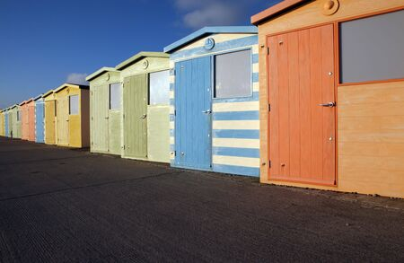 beach huts in seaford by brighton in sussex england. colorful sheds by the seaside against bright blue sky Stock Photo - 6845139