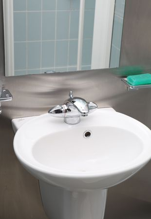 bathroom ceramic sink in stainless steel inter. taps and soap in modern restroom Stock Photo - 6845093