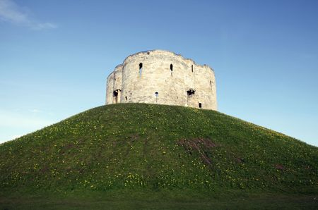 Cliffords Tower in the city of York. Ancient medieval historic fortress photo