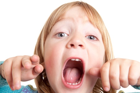 yell: screaming child, kid yell or shout in anger isolated on white Stock Photo