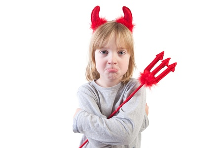 child dressed up as devil with horns and pitchfork. naughty kid in halloween costume Stock Photo
