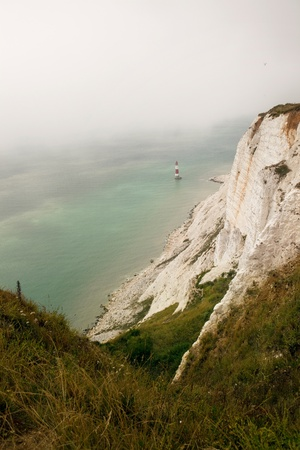 cliff coastline in england. chalk cliffs of beachy head part of seven sisters by the sea on foggy day Stock Photo - 8493125