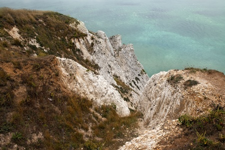 cliff coastline in england. chalk cliffs of beachy head part of seven sisters by the sea on foggy day Stock Photo - 8311496