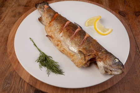 fish dinner of rainbow trout. fresh healthy meal on plate photo