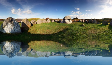 megalith: stone age or viking burial site in Denmark. stones reflection in water of historic grave