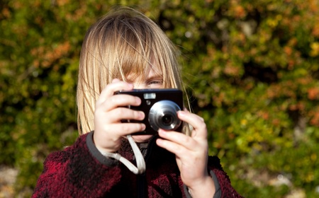 Child taking a photo. Boy photographer photographing nature with digital camera Stock Photo - 8793292
