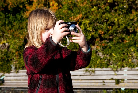 Child taking a photo. Boy photographer photographing nature with digital camera Stock Photo - 8793296
