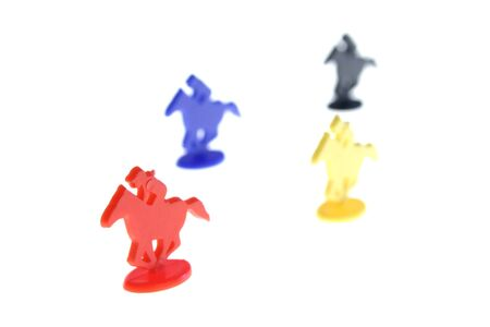 horse race toys. plastic toy horses racing to win and claim victory isolated on white photo