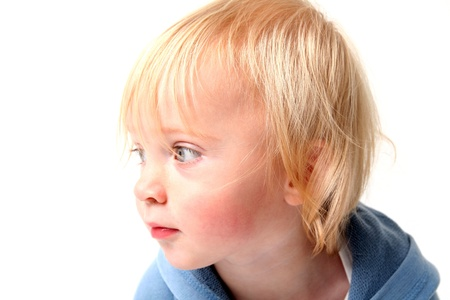 adorable child boy isolated on white. very cute caucasian kid with blonde or blond hair. portrait of scandinavian toddler Stock Photo - 10316217