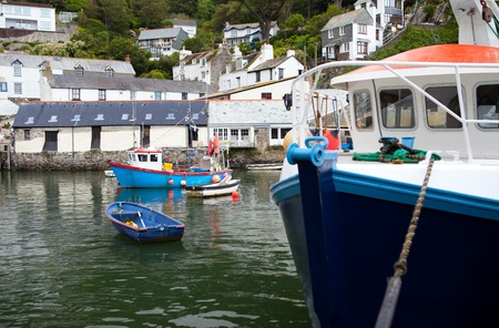 cornish: fishing boats in historic village Polperro in Cornwall. Cornish Harbor with boats and cottages
