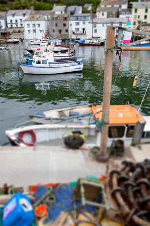 seafront: fishing boats in historic village Polperro in Cornwall. Cornish Harbor with boats and cottages