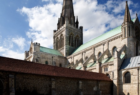 steeples: Chichester cathedral, christian church in Sussex England. historic religious architecture with tower and spire