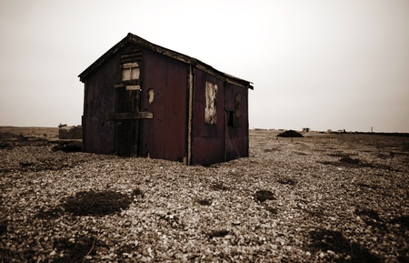 fishing hut or shag on beach. abandoned cabin at Dungeness in England Stock Photo - 11530412