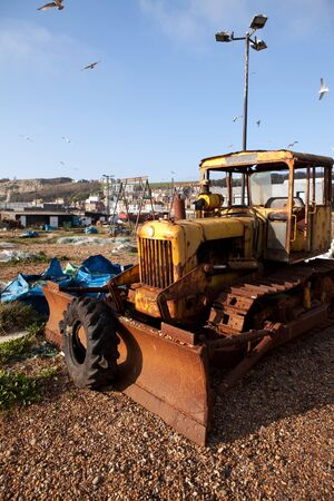 bulldozer on beach or coast, machine used by fishing industry in Hastings. East-sussex town and shoreline in England. Stock Photo - 11530438