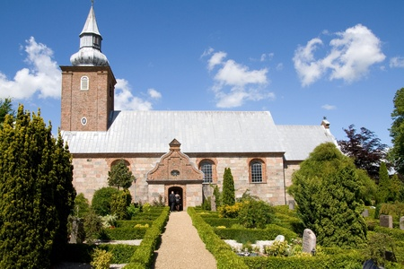 Church, scandinavian medieval place of worship. graveyard and Danish religious architecture photo