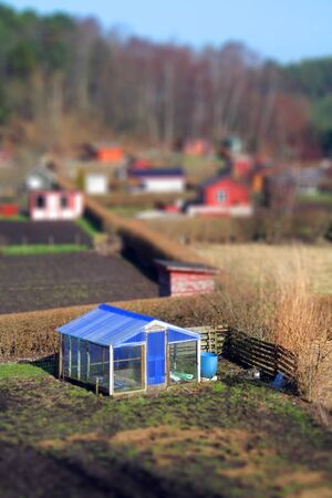 hobby hut: allotment and greenhouse, plot of land with building or cabins Stock Photo