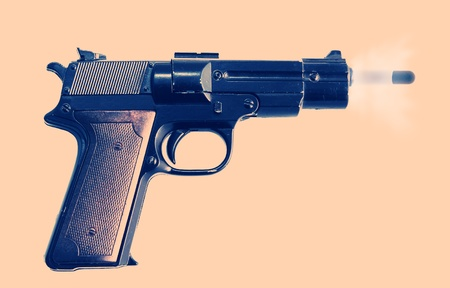gun or pistol evidence of a crime or security and protection. gunshot with bullet and smoke photo