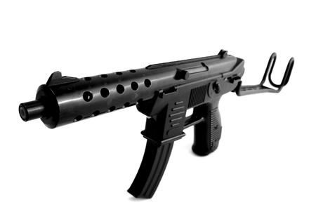 criminal defense: machine gun isolated on white. toy plastic assault rifle weapon