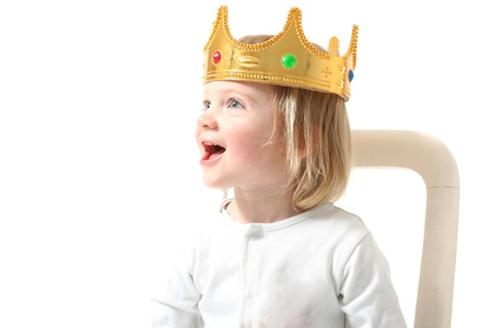 gold crown: child king with crown isolated on white. Happy toddler with royal head gear smiling having fun