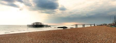 brighton beach: Brighton westpier and beach, the old burned down pier in evening light