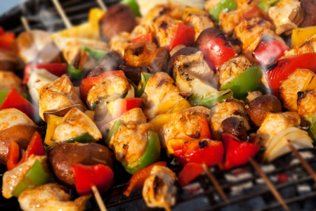 chicken meat: Bar-B-Q or BBQ with kebab cooking. coal grill of chicken meat skewers with mushroom and peppers. barbecuing dinner Stock Photo