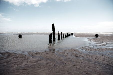 Beach or coast at Winchelsea in england sussex with view of groyne wood pillars Stock Photo - 16240651