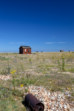 abandoned fishing hut or shed. old wooden cabin on south coast of england in Dungeness Stock Photo - 16240781