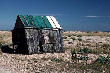 abandoned fishing hut or shed. old wooden cabin on south coast of england in Dungeness Stock Photo - 16240654