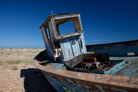 abandoned fishing trawler on beach. old ship wreck on english south coast in dungeness Stock Photo - 16240599