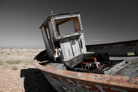 beached: abandoned fishing trawler on beach. old ship wreck on english south coast in dungeness